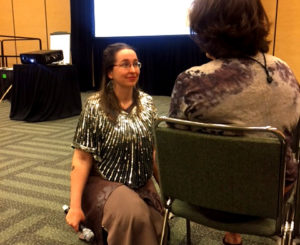Mazarine Treyz at AFP National conference, listening to an attendee